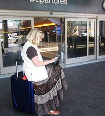 Deirdre-Michalski-on-iPad-at-Airport