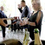Lynn being served wine